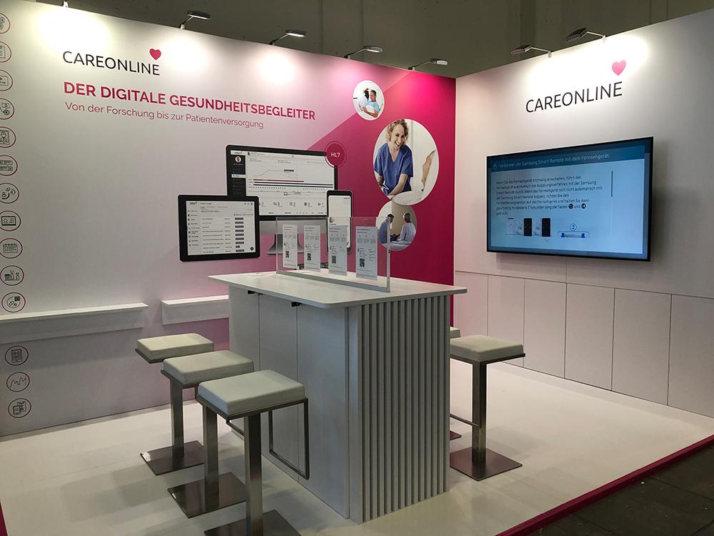 Messestand der Firma Oncare mit ihrem Produkt Careonline auf der DMEA Messe in Berlin 2019